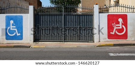 An image of 2 disabled signs on the wall, sign of disability, disabled sign for man and for woman, interesting invalid disabled sign on a gates,Close up of dirty parking sign for disable people,symbol - stock photo