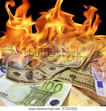 an image of  dollar and euro bills on fire - stock photo