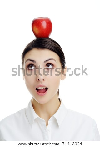 An image of girl with apple on her head. - stock photo
