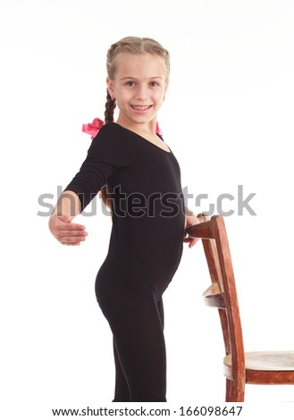 An image of little girl gymnast on white background - stock photo