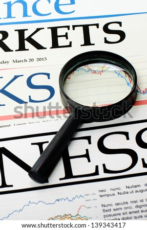 An image of Magnifying glass over  newspapers - stock photo