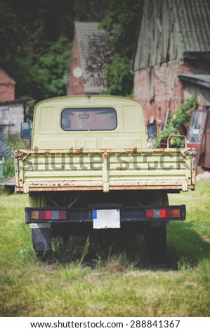 An image of  old antique green pickup - stock photo