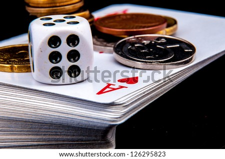An image of playing cards, dice and money - stock photo