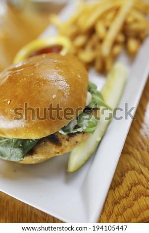 An image of Salmon burger - stock photo