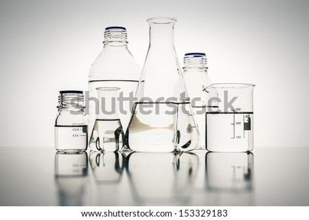 An image of some glass bottles in the laboratory - stock photo