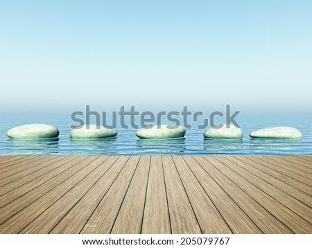 An image of step stones in the blue sea - stock photo