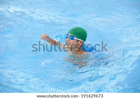 An image of Swimming kid - stock photo