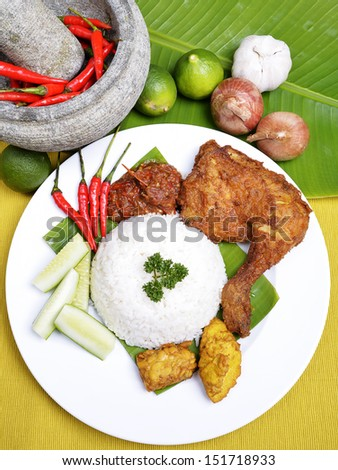 "An image of the famous traditional Malay Food ""Delicious 'Ayam Penyet' with 'Sambal Belacan' and 'Tempe'- local flavor - stock photo"