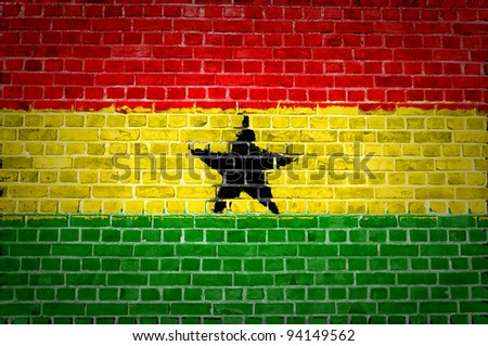 An image of the Ghana flag painted on a brick wall in an urban location - stock photo