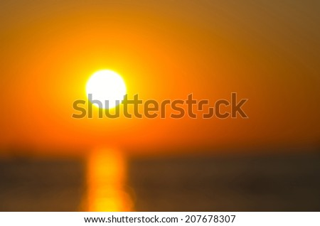 An image of the nice defocused sunset on the sea background. Abstract composition - stock photo