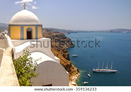 An image of the santorini capital town of fira with landmark church in the foreground overlooking the caldera. - stock photo