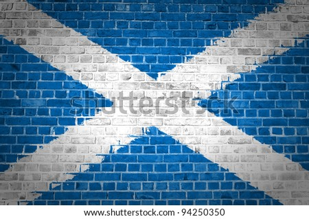 An image of the Scotland Saltire flag painted on a brick wall in an urban location - stock photo