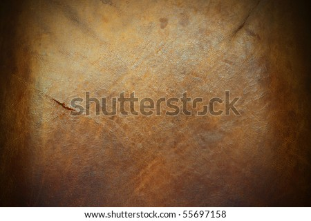 An image of the surface of a piece of old tanned leather hide. - stock photo