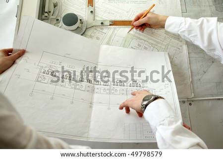 An image of two architects working at the project - stock photo