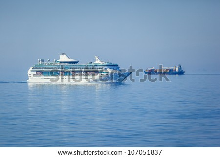 An image of two ships in the blue sea - stock photo