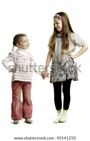 An image of two sisters looking at each other - stock photo