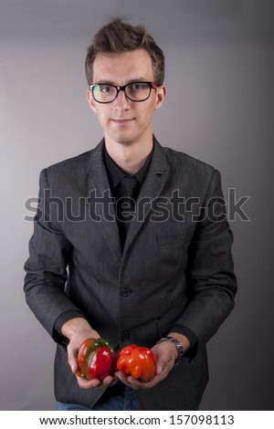 an image of vegetarian vegetable businessman holds in hands - stock photo