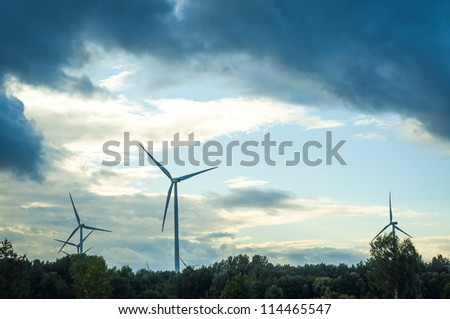 An image of windturbine during beautiful sunset - stock photo
