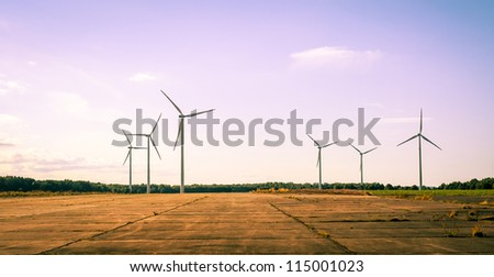 An image of windturbine on sunny day - stock photo