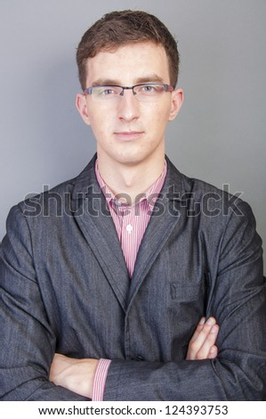 An image of young businessmen portrait in studio - stock photo