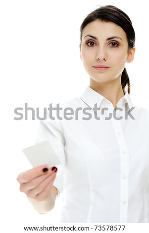 An image of young businesswoman holding blank businesscard in hand - stock photo
