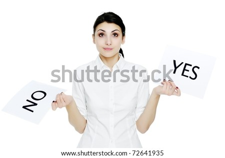 An image of young businesswoman holding sheet of paper with inscription NO and YES - stock photo