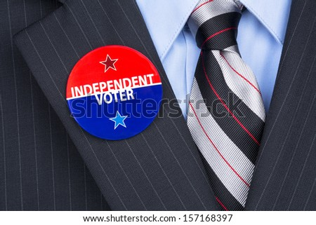 An independent voter wears his party pin on his suit lapel - stock photo