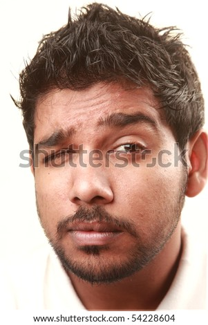 An Indian young showing doubtfulness - stock photo