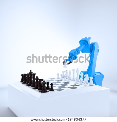 An industrial robot playing chess - stock photo