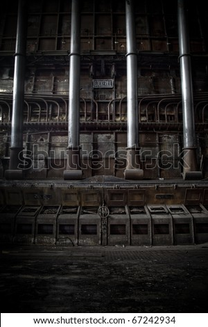 An industrial scene at an abandoned factory, old pipes rising like an organ. - stock photo