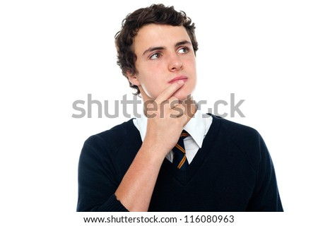 An intellectual student trying to recollect the answer isolated over white background - stock photo