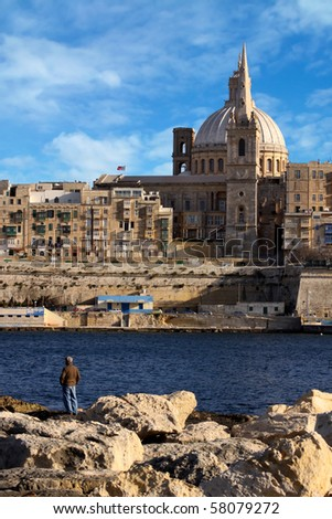 An interesting vertical view of the Valletta skyline on a nice sunny day - stock photo