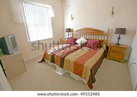 An Interior Home shot of a King Master Bedroom - stock photo