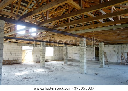 An interior view of a new home under construction. Wooden framing - stock photo
