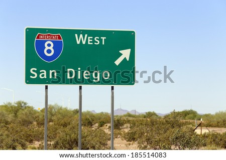 An interstate highway sign points the way to San Diego, California. - stock photo