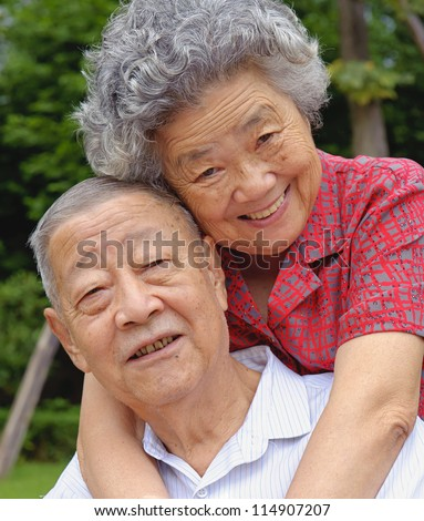 an intimate senior couple embraced - stock photo