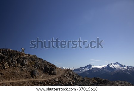 An Inukshuk at the top of the Peak in Whistler, BC - stock photo