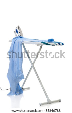 An ironing board with iron and a shirt on a white background - stock photo