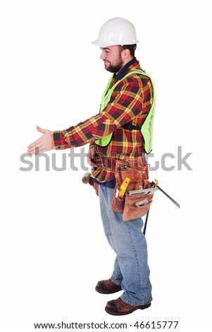 an isolated contractor with his hand out for a handshake - stock photo