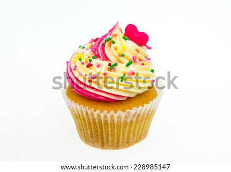 An isolated cupcake with sprinkles on a white background  - stock photo