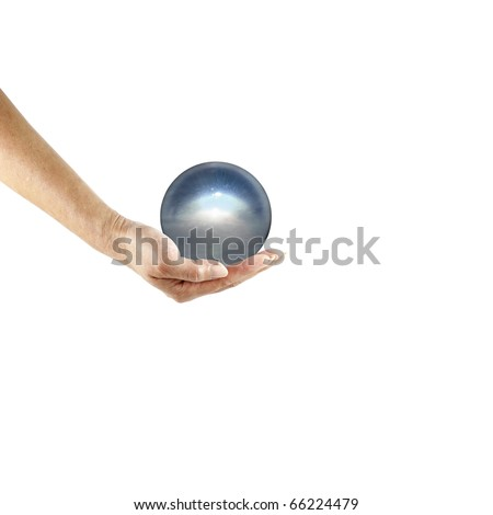 An isolated cutout of a female hand holding a translucent crystal orb. - stock photo