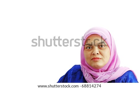 An isolated cutout of a mature Muslim lady wearing a pink head scarf. - stock photo