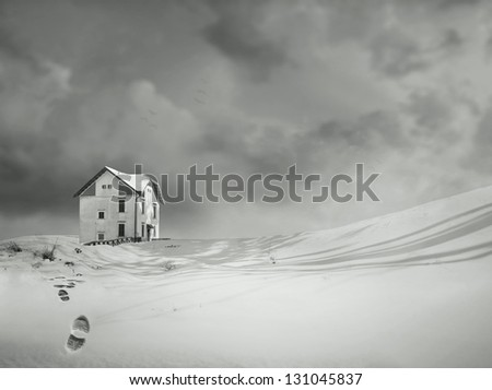 An isolated house in a wonderful snowy landscape and dramatic sky in black and white - stock photo