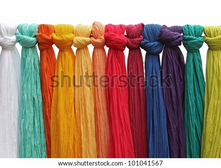 An isolated shot from colorful shawls made of silk fabrics. - stock photo