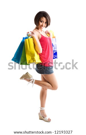 An isolated shot of a beautiful black woman carrying shopping bags - stock photo
