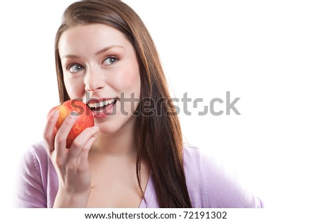 An isolated shot of a beautiful caucasian woman eating an apple - stock photo