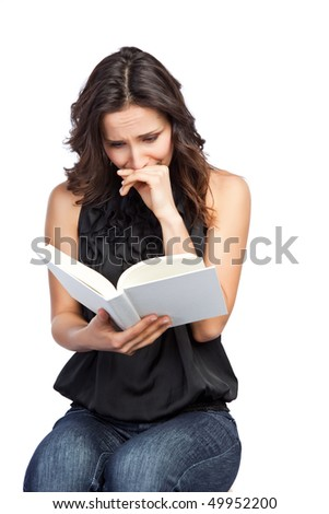 An isolated shot of a beautiful woman reading a book - stock photo