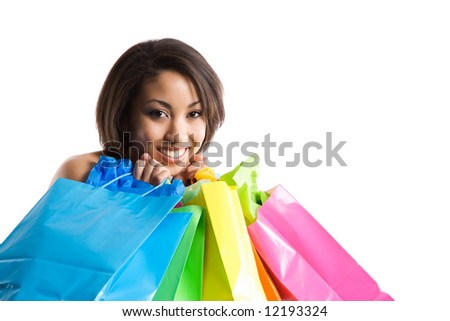 An isolated shot of a black woman carrying shopping bags - stock photo
