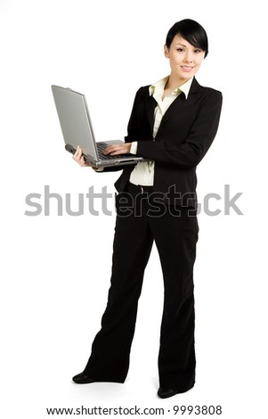 An isolated shot of a businesswoman working on her laptop - stock photo