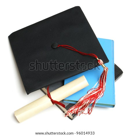 An isolated shot of a Grad hat and books from a high achieving student. - stock photo